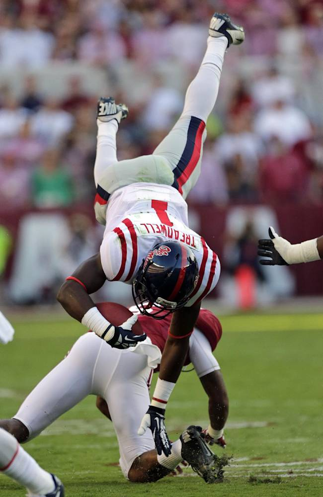 Mississippi wide receiver Laquon Treadwell (1) is upended by Alabama defensive back Ha Ha Clinton-Dix (6) during the first half of an NCAA college football game in Tuscaloosa, Ala., Saturday, Sept. 28, 2013