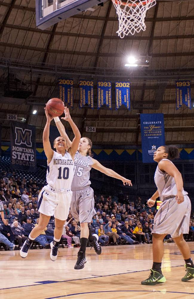 In this photo provided by Montana State University, Montana State guard Margreet Barhoum (10) makes a scoring drive against Portland State during the first half of an NCAA college basketball game on Thursday, Jan. 9, 2014, in Bozeman, Mont