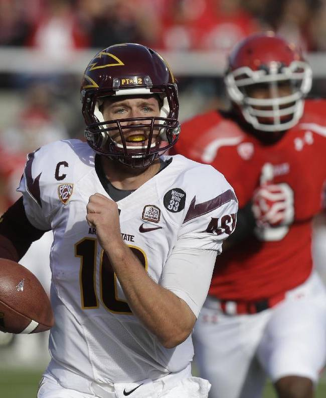 Arizona State quarterback Taylor Kelly (10) carries the ball for a touchdown in the first quarter during an NCAA college football game against Utah on Saturday, Nov. 9, 2013, in Salt Lake City