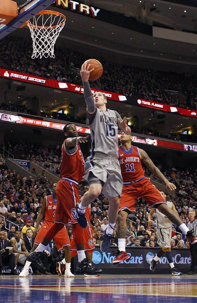 Villanova's Ryan Arcidiacono, center, goes up for the shot as he got past St. John's Jakarr Sampson, left, and D'Angelo Harrison, right, during the second half of an NCAA college basketball game, Saturday, Feb. 22, 2014, in Philadelphia. Villanova won 57-54
