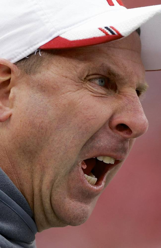 Nebraska head coach Bo Pelini yells at his players after Illinois scored a safety in the first half of an NCAA college football game in Lincoln, Neb., Saturday, Oct. 5, 2013