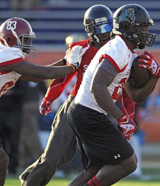 South Squad running back Lorenzo Taliaferro, of Coastal Carolina, carries the ball as wide receiver Kevin Norwood, of Alabama, blocks Walt Aikens, of Liberty, during Senior Bowl college football practice at Ladd-Peebles Stadium, Thursday, Jan. 23, 2014, in Mobile, Ala