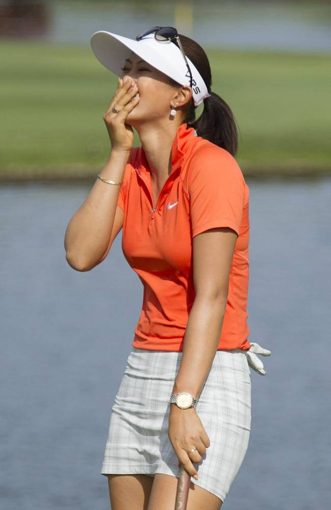 Michelle Wie reacts to winning the 2014 LPGA LOTTE Championship golf tournament on the 18th green at Ko Olina Golf Club, Saturday, April 19, 2014, in Kapolei, Hawaii