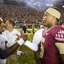 FILE - In this Oct. 18, 2014, file photo, Florida State quarterback Jameis Winston, right, greets Notre Dame quarterback Everett Golson after Florida State won 31-27 in an NCAA college football game in Tallahassee, Fla.Former Notre Dame quarterback Everett Golson says he is transferring to Florida State, where he will have the chance to replace Jameis Winston. In a statement to Fox Sports, Golson said Tuesday, May 19, 2015, after much consideration he will spend his fifth year of eligibility with the Seminoles. (AP Photo/Mark Wallheiser, File)