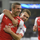 Arsenal's Lukas Podolski, left, is hugged after he scored 2-1 during the Group D Champions League match between Anderlecht and Arsenal at Constant Vanden Stock Stadium in Brussels, Belgium, Wednesday Oct. 22, 2014