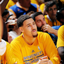 OAKLAND, CA - MAY 27: Klay Thompson #11 of the Golden State Warriors sits on the sideline during a game against the Houston Rockets in Game Five of the Western Conference Finals of the 2015 NBA Playoffs on May 27, 2015 at Oracle Arena in Oakland, California. (Photo by Noah Graham/NBAE via Getty Images)