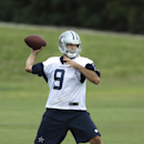 File- This June 18, 2014, file photo shows Dallas Cowboys quarterback Tony Romo passing during an NFL football minicamp, in Irving, Texas. Romo probably won't have to sneak into competitive situations when the Dallas Cowboys hold their first training camp