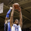 Duke's Jahlil Okafor drives to the basket in front of Rasheed Sulaimon as the team kicks off its NCAA college basketball season in a scrimmage during Countdown to Craziness at Cameron Indoor Stadium in Durham, N.C., Saturday, Oct. 25, 2014. (AP Photo/Gerry Broome)