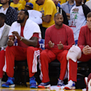 Los Angeles Clippers players sit on the bench wearing their warm-up tops inside out against the Golden State Warriors in Game Four of the Western Conference Quarterfinals during the 2014 NBA Playoffs at ORACLE Arena on April 27, 2014 in Oakland, California. The players wore theirs warm up this way in protest of owner Donald Sterling's racially insensitive remarks. (Photo by Thearon W. Henderson/Getty Images)
