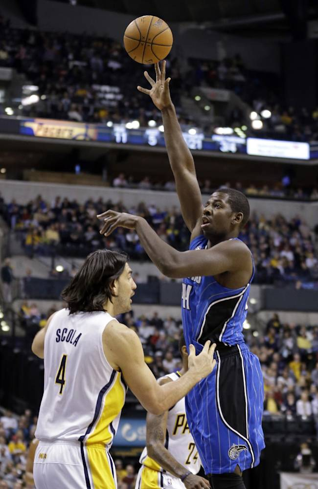 Orlando Magic forward Andrew Nicholson, right, shoots over Indiana Pacers forward Luis Scola in the first half of an NBA basketball game in Indianapolis, Monday, Feb. 3, 2014