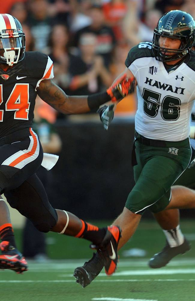 In this Sept. 7, 2013, file photo, Oregon State running back Storm Woods (24) carries the ball as Hawaii linebacker Brenden Daley (56) gives chase in the first quarter of an NCAA college football game in Corvallis, Ore. On Saturday, Utah hosts Oregon State, a team that has struggled to find its offense after the first two games of the season