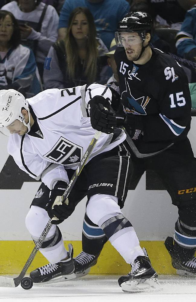 Los Angeles Kings' Slava Voynov, left, and San Jose Sharks' James Sheppard vie for the puck during the first period of Game 1 of an NHL hockey first-round playoff series Thursday, April 17, 2014, in San Jose, Calif