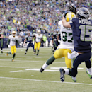 Green Bay Packers' Sam Shields (37) intercepts a pass in front of Seattle Seahawks' Jermaine Kearse (15) during the first half of the NFL football NFC Championship game Sunday, Jan. 18, 2015, in Seattle The Associated Press