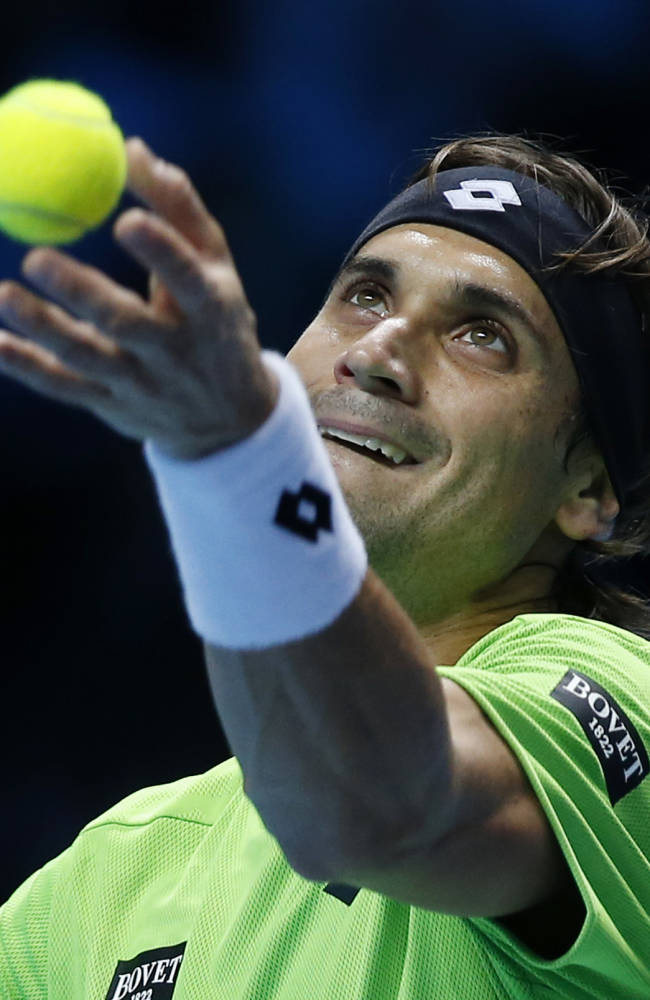 David Ferrer of Spain serves to Tomas Berdych of Czech Republic during their ATP World Tour Finals single tennis match at the O2 Arena in London Wednesday, Nov. 6, 2013