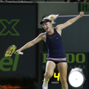 Daria Gavrilova of Russia, celebrates after upsetting Maria Sharapova of Russia, 7-6 (4), 6-3, at the Miami Open tennis tournament, Thursday, March 26, 2015 in Key Biscayne, Fla. (AP Photo/Wilfredo Lee)