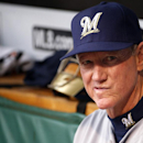 FILE - In an April 18, 2015, file photo Milwaukee Brewers manager Ron Roenicke sits in the dugout before a baseball game against the Pittsburgh Pirates in Pittsburgh. The Milwaukee Brewers fired manager Ron Roenicke on Sunday night, May 3, 2015, hours after their 5-3 victory over the Cubs in Chicago. (AP Photo/Gene J. Puskar, file )