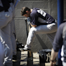 New York Yankees' Mark Teixeira waits to bat in the dugout in the sixth inning of an exhibition spring training baseball game against the Washington Nationals, Tuesday, March 11, 2014, in Viera, Fla The Associated Press