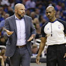 Brooklyn Nets head coach Jason Kidd, left, has a discussion with referee Tom Washington, right, during the second half of an NBA basketball game against the Orlando Magic in Orlando, Fla., Wednesday, April 9, 2014. Orlando won 115-111 The Associated Press