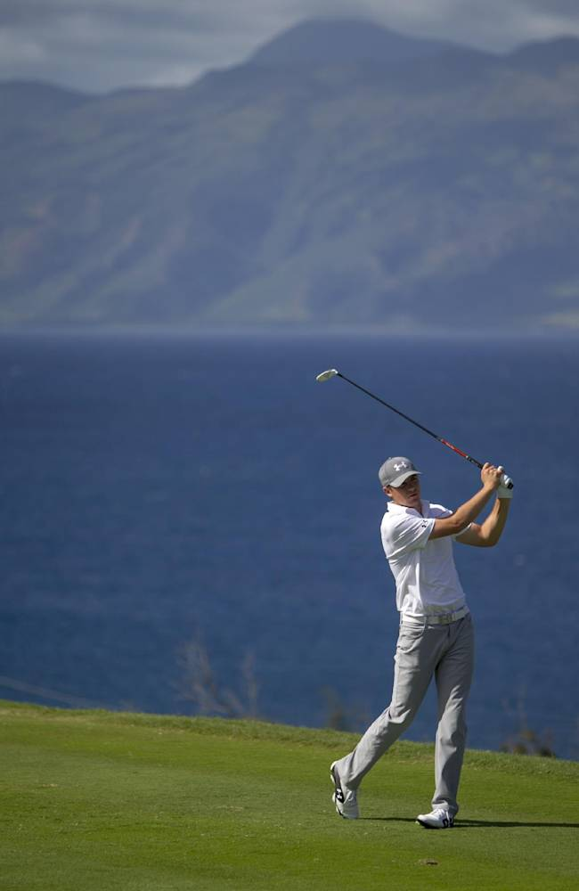 Jordan Spieth drives on the 13th green during the final round of the Tournament of Champions golf tournament, Monday, Jan. 6, 2014, in Kapalua, Hawaii