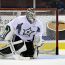 Dallas Stars goalie Jack Campbell keeps his eyes on a loose puck during a team work out on opening day of NHL NHL hockey training camp, Friday, Sept. 19, 2014, in Fort Worth, Texas The Associated Press