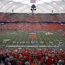 The Syracuse marching band performs before Syracuse plays Northwestern in NCAA college football game in Syracuse, N.Y., Saturday, Sept. 1, 2012. Northwestern won the game 42-41. (AP Photo/Hans Pennink)