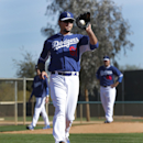 Los Angeles Dodgers pitcher Josh Beckett fields a ball at first base during spring training baseball practice Tuesday, Feb. 11, 2014, in Glendale, Ariz The Associated Press