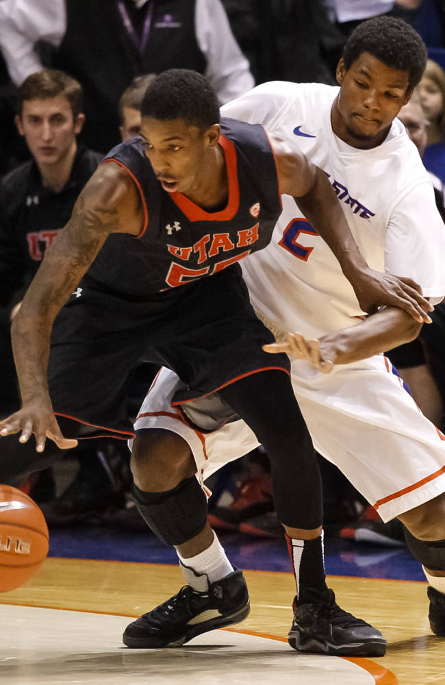 Utah's Delon Wright (55) defends the ball from Boise State's Derrick Marks (2) during the second half of an NCAA college basketball game in Boise, Idaho, on Tuesday, Dec. 3, 2013. Boise State beat Utah 69-67