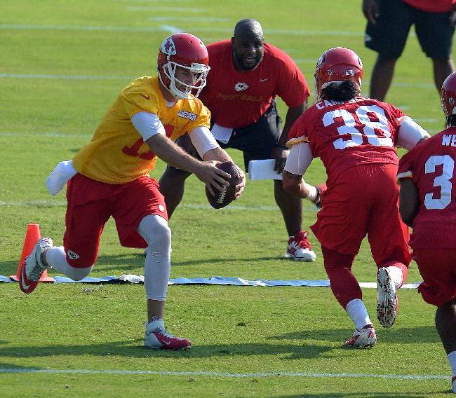 Kansas City Chiefs NFL football quarterback Alex Smith (11) fakes a handoff during practice Monday morning July 21, 2014, on the Missouri Western State University campus in St. Joseph. Mo