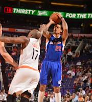PHOENIX, AZ - MARCH 4: Matt Barnes #22 of the Los Angeles Clippers shoots over P.J. Tucker #17 of the Phoenix Suns on March 4, 2014 at U.S. Airways Center in Phoenix, Arizona. (Photo by Barry Gossage/NBAE via Getty Images)