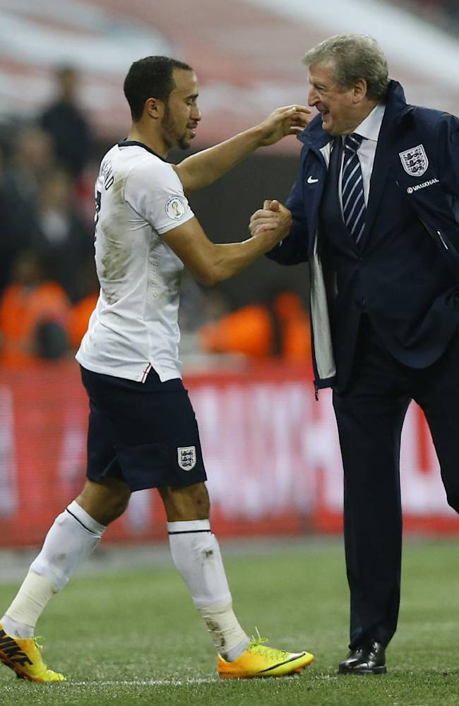 England's manager Roy Hodgson, right shakes hands with his player Andros Townsend at the end of the  World Cup Group H qualification soccer match between England and Poland at Wembley stadium in London, Tuesday, Oct. 15, 2013. England won the game 2-0 and qualify for the World Cup in Brazil 2014