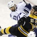 Gregory Campbell contributes for Bruins with goal, fight photo