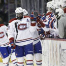 Montreal Canadiens' P.K. Subban (76) high-fives his bench after scoring against the Winnipeg Jets during the second period of an NHL hockey game, Thursday, March 26, 2015 in Winnipeg, Manitoba. (AP Photo/The Canadian Press, John Woods)