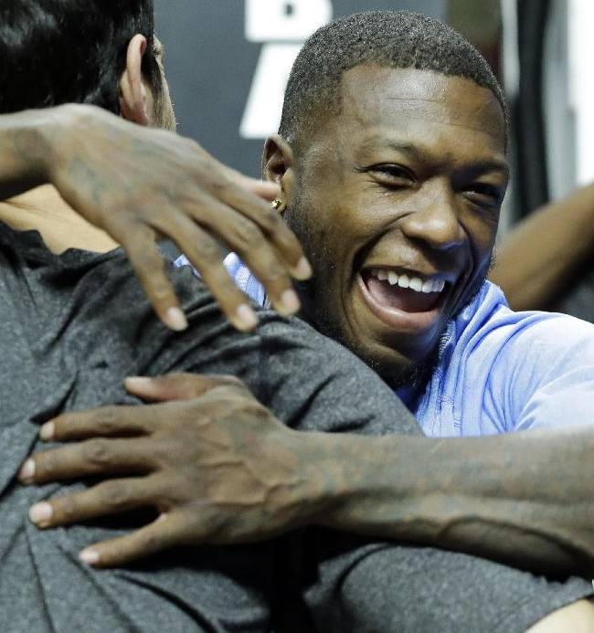 Denver Nuggets guard Nate Robinson, right, hugs Chicago Bulls guard Kirk Hinrich before an NBA preseason basketball game in Chicago on Friday, Oct. 25, 2013