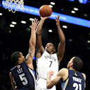 Brooklyn Nets shooting guard Joe Johnson (7) scores over Memphis Grizzlies shooting guard Courtney Lee (5) and Grizzlies' Tayshaun Prince (21)in the first half of an NBA basketball game on Wednesday, March 5, 2014, in New York The Associated Press