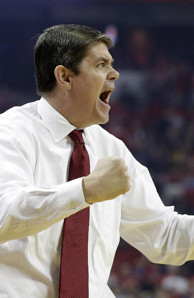 UNLV head coach Dave Rice instructs his team during the second half of an NCAA college basketball game against Colorado State on Wednesday, Feb. 26, 2014, in Las Vegas. UNLV defeated Colorado State 78-70