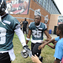 Philadelphia Eagles' LeSean McCoy (25) and Damaris Johnson greet fans as they take the field during NFL football minicamp on Saturday, July 26, 2014, in Philadelphia The Associated Press