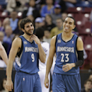 Minnesota Timberwolves' Kevin Martin, right, and Ricky Rubio, of Spain, laugh during the closing moments of the Timberwolves 108-97 win over the Sacramento Kings in a NBA basketball game in Sacramento, Calif., Saturday, March 1, 2014 The Associated Press