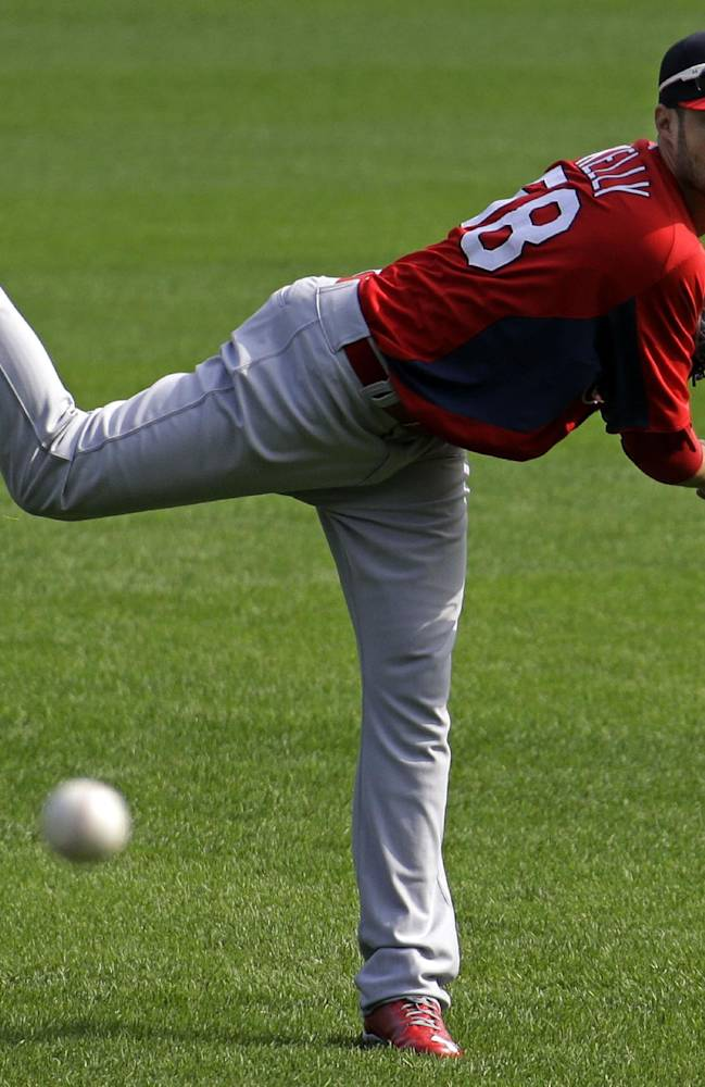 St. Louis Cardinals pitcher Joe Kelly throws in the outfield during a baseball workout in Pittsburgh, Saturday, Oct. 5, 2013. Kelly is scheduled to start Game 3 of the National League division series against the Pittsburgh Pirates on Sunday