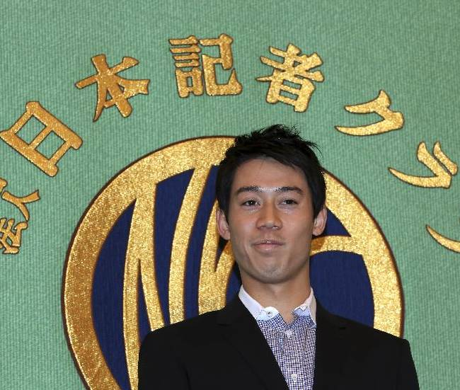 Japanese tennis player Kei Nishikori attends during a press conference at Japan National Press Club in Tokyo, Tuesday, Nov. 18, 2014.  Two-time defending champion Novak Djokovic overcame a lapse of concentration to beat Kei Nishikori 6-1, 3-6, 6-0 and advance to a third straight final at the ATP Finals on Saturday