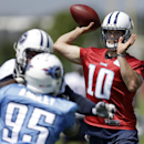 Tennessee Titans quarterback Jake Locker (10) passes as defensive end Kamerion Wimbley (95) rushes during an NFL football training camp on Saturday, July 26, 2014, in Nashville, Tenn The Associated Press