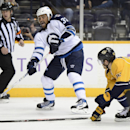 Winnipeg Jets defenseman Dustin Byfuglien (33) takes the puck past Nashville Predators defenseman Mattias Ekholm (42), of Sweden, in the first period of an NHL hockey game on Saturday, March 1, 2014, in Nashville, Tenn The Associated Press