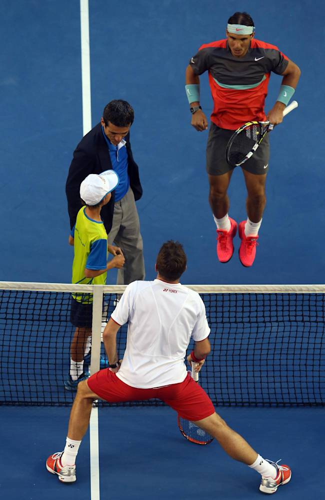Rafael Nadal of Spain, top, and Stanislas Wawrinka of Switzerland, bottom, warm up prior to the men's singles final at the Australian Open tennis championship in Melbourne, Australia, Sunday, Jan. 26, 2014