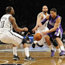 Brooklyn Nets' Marcus Thornton (10) watches as Deron Williams (8) knocks the ball loose from Sacramento Kings' Ray McCallum (3) in the second half of an NBA basketball game on Sunday, March 9, 2014 at Barclays Center in New York. The Nets won 104-89 The A