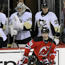 New Jersey Devils' Jaromir Jagr (68), of Czech Republic, celebrates his unassisted empty-net goal with Travis Zajac (19) as Pittsburgh Penguins goaltenders Marc-Andre Fleury and Jeff Zatkoff (37) stand by during the third period of an NHL hockey game Satu