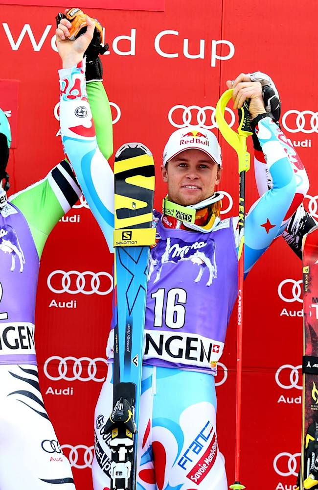France's Alexis Pinturault, center, winner of an alpine ski, men's World Cup slalom, celebrates on the podium with second placed Felix Neureuther, of Germany, left, and third placed Marcel Hirscher, of Austria, in Wengen, Switzerland, Sunday, Jan. 19, 2014