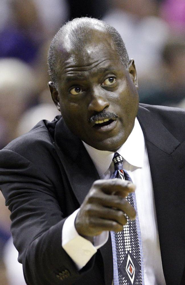 In this July 22, 2009, file photo, Los Angeles Sparks coach Michael Cooper directs his team against the Seattle Storm in the second overtime of a WNBA basketball game in Seattle. The Atlanta Dream named former NBA star Cooper as its new head coach on Thursday, Nov. 21, 2013, hoping he can lead the team to a WNBA championship after three winless trips to the finals