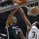 Brooklyn Nets' Shaun Livingston (14) goes up against Milwaukee Bucks' John Henson in the first half of an NBA basketball game, Saturday, March 1, 2014, in Milwaukee The Associated Press