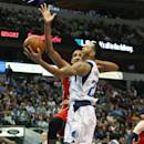 DALLAS, TX - MARCH 02:  Devin Harris #20 of the Dallas Mavericks takes a shot against Alexis Ajinca #42 of the New Orleans Pelicans at American Airlines Center on March 2, 2015 in Dallas, Texas.   NOTE TO USER: User expressly acknowledges and agrees that, by downloading and or using this photograph, User is consenting to the terms and conditions of the Getty Images License Agreement.  (Photo by Ronald Martinez/Getty Images)