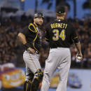 Pittsburgh Pirates catcher Francisco Cervelli, left, speaks with pitcher A.J. Burnett (34) as they wait for a review of a two-run home run hit by San Francisco Giants' Brandon Crawford during the third inning of a baseball game Tuesday, June 2, 2015, in San Francisco. (AP Photo/Ben Margot)