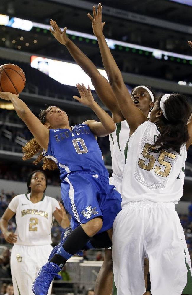 Kentucky's Jennifer O'Neill (0) goes up for a shot-attempt against Baylor's Khadijiah Cave (55) and Sune Agbuke, rear, as Niya Johnson (2) watches in overtime of an NCAA college basketball game, Friday, Dec. 6, 2013, in Arlington, Texas. O'Neill led her team in scoring with 43-points in the 133-130 four-overtime win over Baylor